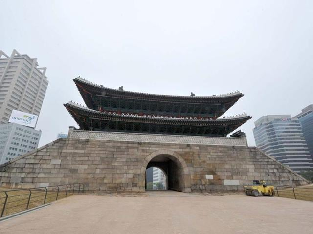 The-newly-restored-Namdaemun-gate-a-treasured-14th-century-historical-landmark-burned-to-the-ground-in-an-arson-attack-in-2008-stands-in-Seoul-Thousands-of-traditional-craftsmen-were-mobilised-for-five-years-of-elaborate-work-to-restore-the-gate-The-gate-will-be-officially-opened-on-May-4-2013-Photo-AFP-Kim-Jae-Hwan