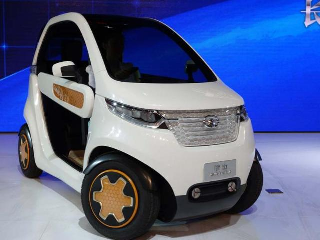 Great Wall Kulla EV concept : The Chinese answer to the Renault Twizzy, this all-electric 1+1 (it can carry two people, one behind the other) churns out 15bhp, can travel 100km and takes 4.5 hours to recharge. Electric cars have been slow to catch on in China but the Kulla's makers are hoping that there will be enough interest to take this model from concept to production. Photo:AFP