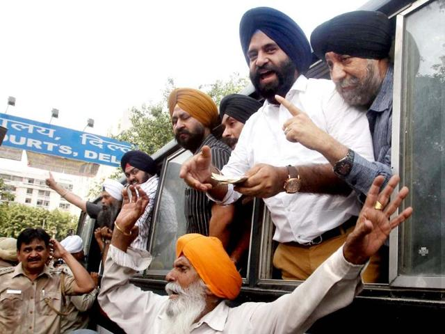 Victims-of-1984-anti-Sikh-riots-shout-slogans-after-they-are-detained-during-a-protest-outside-Karkardooma-court-after-a-hearing-in-the-case-in-New-Delhi-The-court-acquitted-Sajjan-Kumar-in-a-case-related-to-the-1984-anti-Sikh-riots-PTI-Photo