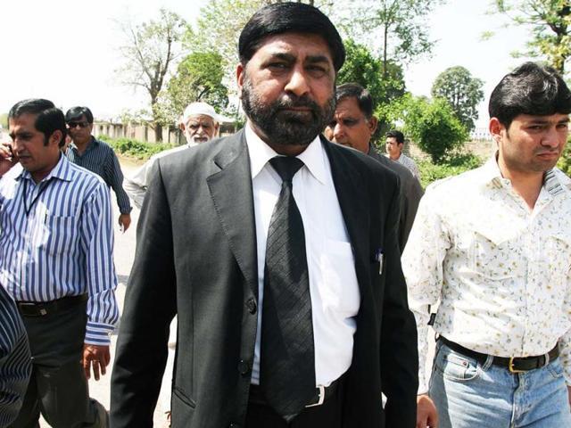 Pakistani-special-prosecutor-lawyer-Chaudhry-Zulfiqar-Ali-walks-with-others-as-he-leaves-Adiyala-Prison-in-Rawalpindi-AFP-files