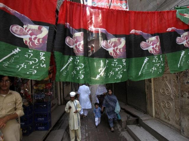 An-alley-of-Peshawar-city-is-decorated-with-campaign-banners-for-the-upcoming-election-in-Peshawar-Pakistan-AP-Photo