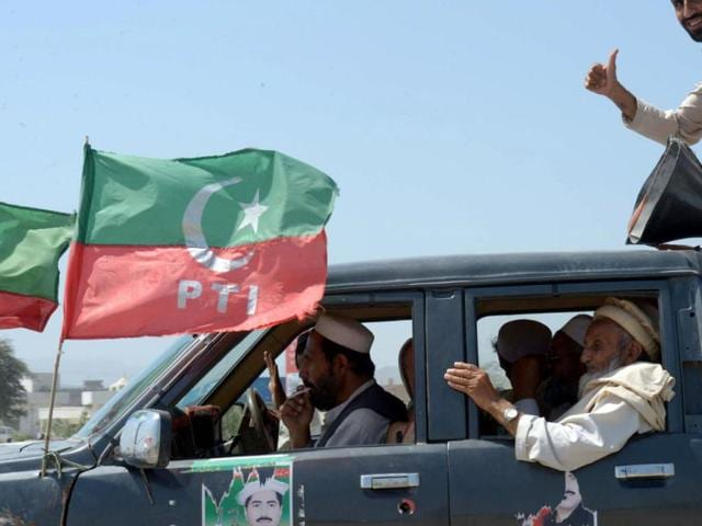 This-photo-shows-supporters-of-cricket-legend-and-chairman-of-Pakistan-Tehreek-e-Insaaf-PTI-Imran-Khan-ride-on-a-vehicle-during-an-election-campaign-in-Jamrud-Khyber-district-AFP