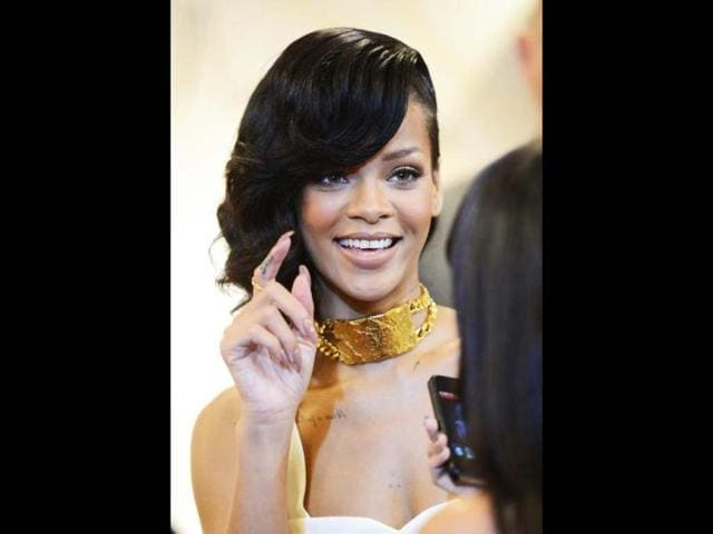 Rihanna-brings-back-her-bangs-as-she-arrives-for-the-premiere-of-Battleship-in-Los-Angeles-on-May-10-2012-AFP-Photo