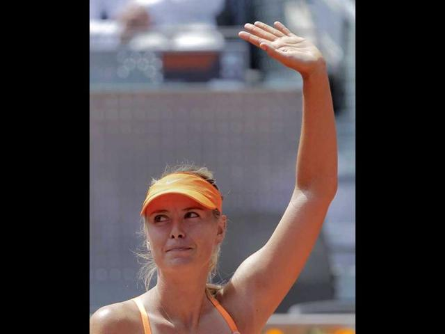 Maria-Sharapova-celebrates-after-winning-the-match-against-Alexandra-Dulgheru-during-the-Madrid-Open-tennis-tournament-in-Madrid-AP