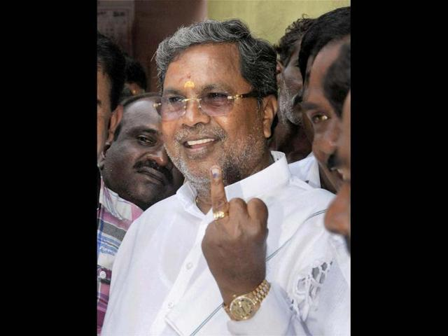 Congress-leader-and-Karnataka-leader-of-Opposition-Siddaramaiah-after-casting-his-vote-during-assembly-elections-at-Veruna-constituency-in-Karnataka-PTI-Photo