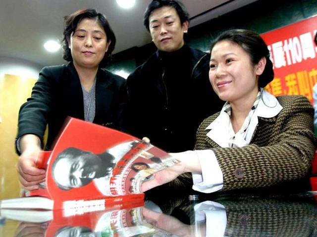 In-this-Dec-2003-photo-granddaughter-of-the-late-Chinese-revolutionary-Mao-Zedong-Kong-Dongmei-R-signs-copies-of-the-new-pictorial-book-on-the-life-of-her-grandfather-at-a-bookstore-in-Beijing-AFP-photo-files