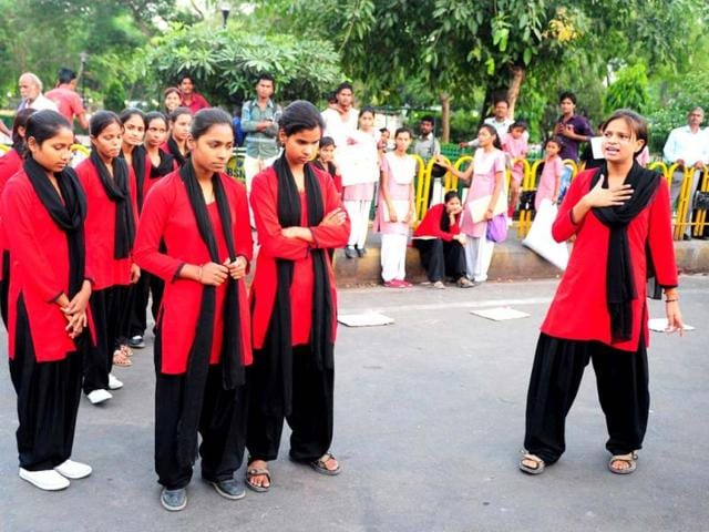 Red-Brigade-take-part-in-a-street-play-in-Lucknow-Red-Brigade-is-a-group-of-angry-young-women-challenging-deeply-ingrained-patriarchal-mindsets-AFP-photo