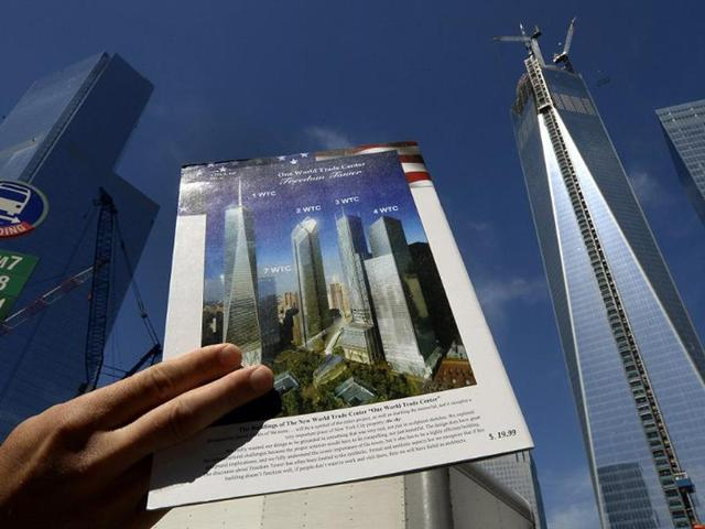 The-final-section-of-the-spire-sits-on-top-of-One-World-Trade-Center-on-May-10-2013-in-New-York-after-it-was-fully-installed-on-the-building-s-roof-Photo-Timothy-A-Clary
