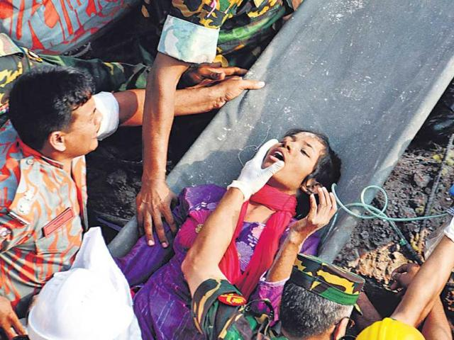 Bangladesh-rescuers-pulled-out-Reshma-Begum-a-survivor-of-the-garment-factory-collapse-after-17-days-of-being-trapped-in-the-rubble-AP