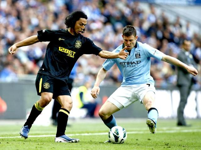 Ben Watson,Wigan Athletic,Manchester City