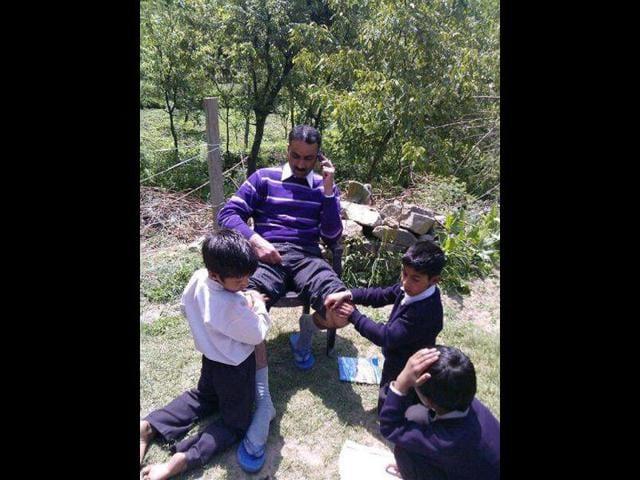Bashir-Ahmad-Bhat-teaches-in-a-middle-school-in-Khiram-Gujran-village-in-Bijbehara