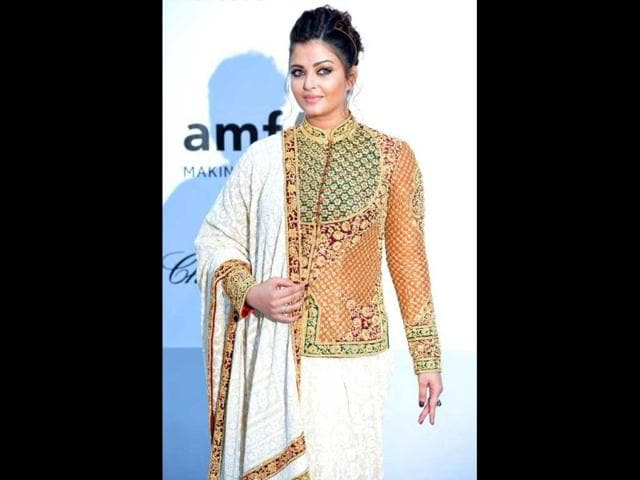 Aishwarya Rai Bachchan finally appears at the red carpet of Cannes Film Festival and how! The actor got her style bang on in an Indian attire by designers Abu Jani and Sandeep Khosla.
