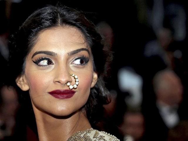Look-back-in-style-Sonam-Kapoor-poses-for-the-photogs-Reuters-Photo