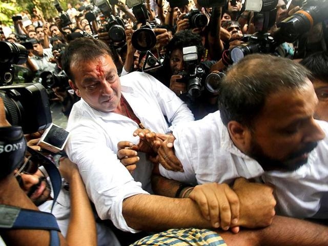 Sanjay-Dutt-is-escorted-by-his-security-staff-as-he-arrives-to-surrender-at-a-court-in-Mumbai-Photo-Reuters