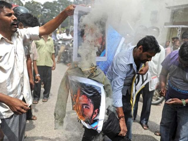 Protestors set fire to posters bearing portraits of cricketer Sreesanth and two other Twenty20 cricketers during a protest against their alleged involvement in spot-fixing, in Bangalore. AFP photo