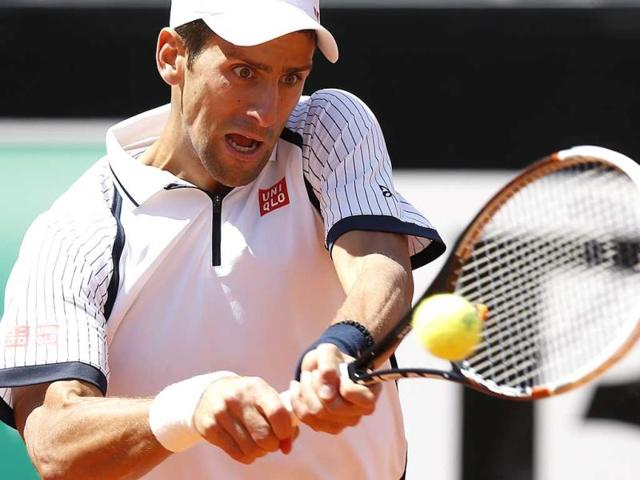 Novak-Djokovic-of-Serbia-hits-a-return-to-Tomas-Berdych-of-Czech-Republic-during-their-men-s-singles-quarter-final-match-at-the-Rome-Masters-tennis-tournament-Reuters-photo