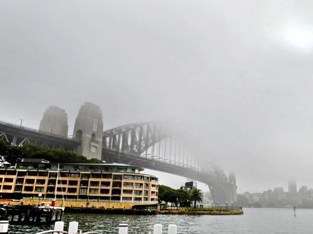 The-sun-breaks-through-fog-sitting-over-Sydney-s-Harbour-Bridge-AFP-photo