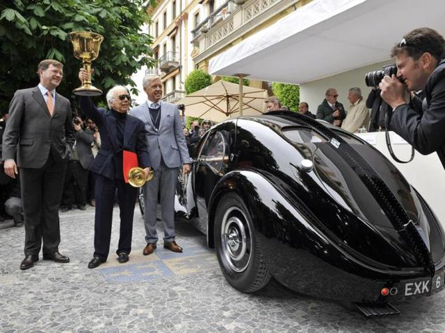 Ralph Lauren : The Bugatti also scooped the Coppa d'Oro Villa d'Este prize, which is awarded by visitors to the event, and the car's owner, fashion designer Ralph Lauren, is clearly enjoying every minute of it. Photo:AFP