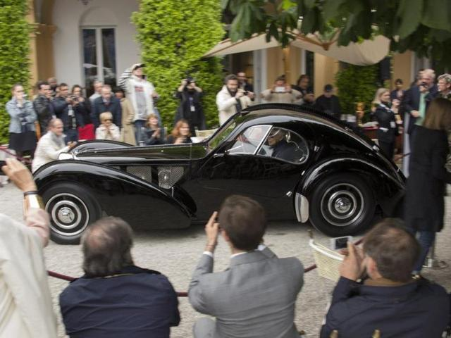 1938 Bugatti 57SC Atlantic : The Concorso d'Eleganza Villa d'Este 2013's ultimate Best of Show award went to this incredible 1938 Bugatti 57SC Atlantic, which isn't surprising, considering that there are only three examples in the entire world and the last time one came up for auction, it sold for $60 million, making it by far the world's most expensive and sought-after classic car. Photo:AFP