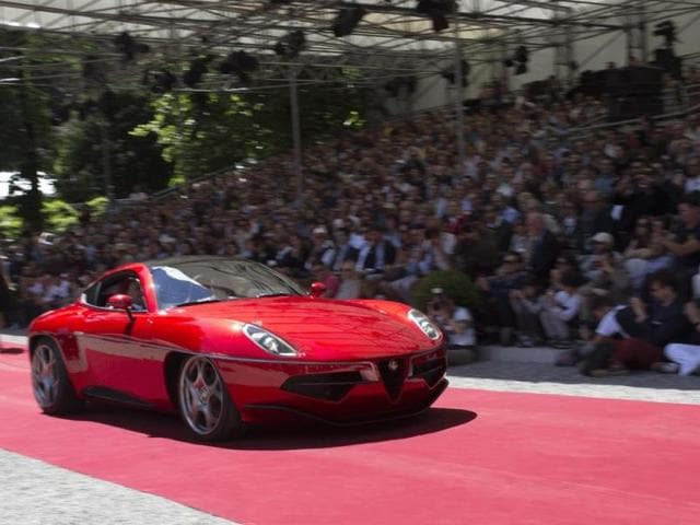 Touring Disco Volante : However, the award for the best prototype or concept car went to Touring for its Disco Volante, a concept (which is now a reality and the company has started taking orders) based on the Alfa Romeo 8C Competizione. The 8C is already one of the world's rarest and most expensive new cars (only 500 examples, priced at $250,000 each) and Touring's approach makes it twice as expensive but also twice as exclusive. Photo:AFP