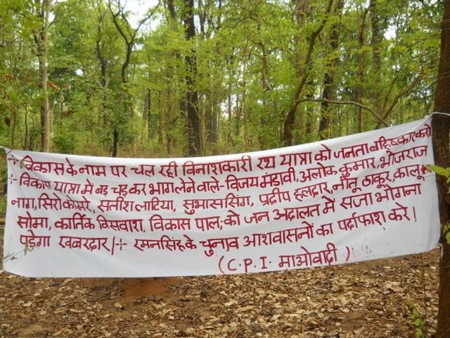 A-banner-put-up-by-Maoists-opposing-the-BJP-s-vikas-yatra-at-Pakhanjur-in-Kanker-district-some-200-km-south-of-Raipur-HT-photo