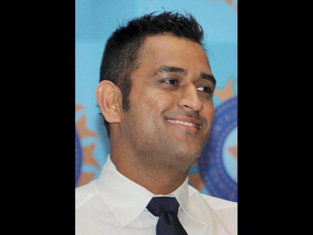 Indian-cricket-captain-Mahender-Singh-Dhoni-smiles-during-a-press-conference-in-Mumbai-before-leaving-for-England-for-the-Champions-Trophy-PTI