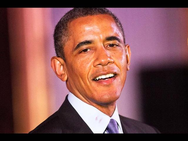 President-Barack-Obama-at-the-beginning-of-the-speech-at-AAPI-pointed-out-a-lipstick-mark-on-his-collar-saying-it-was-from-the-aunt-of-American-Idol-runner-up-Jessica-Sanchez-AP-photo