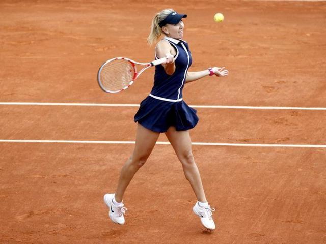 Azarenka through,no sister act for Radwanska,Roland Garros