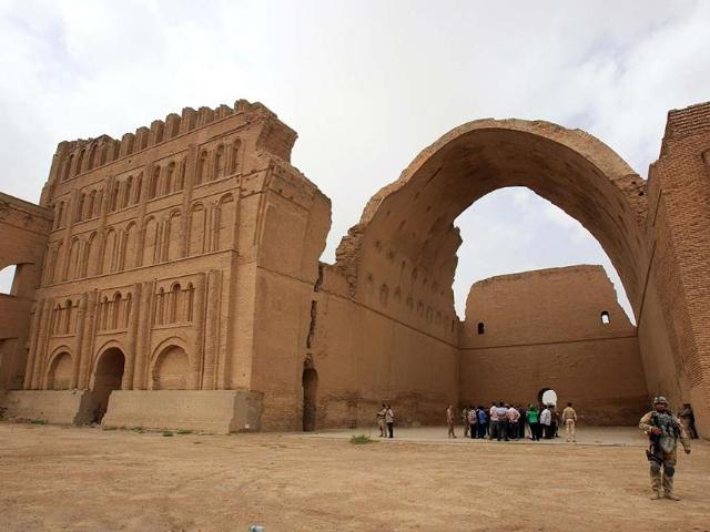 Iraqis-stand-under-the-arch-of-the-barrel-vaulted-hall-of-the-Ctesiphon-palace-which-was-in-the-imperial-capital-of-the-Persian-Empire-in-the-Parthian-and-Sassanian-times-near-Madean-30-kilometres-south-of-Baghdad-Photo-AFP-Ali-Al-Saadi