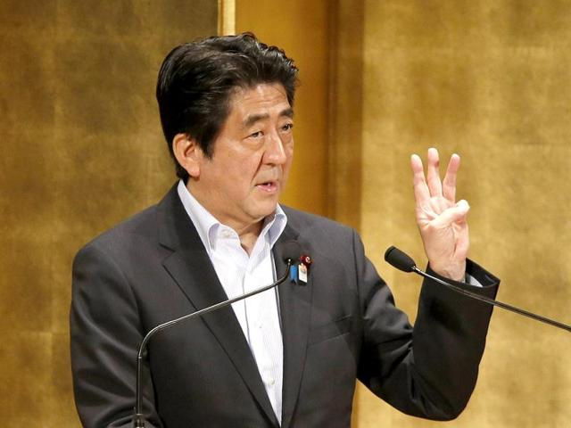 Japan-s-Prime-Minister-Shinzo-Abe-delivers-a-speech-at-a-seminar-in-Tokyo-Reuters