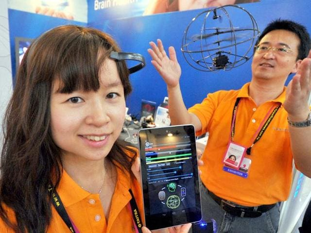 Staff-display-NeuroSky-s-new-products-during-the-2013-Computex-in-Taipei-Photo-AFP-Mandy-Cheng