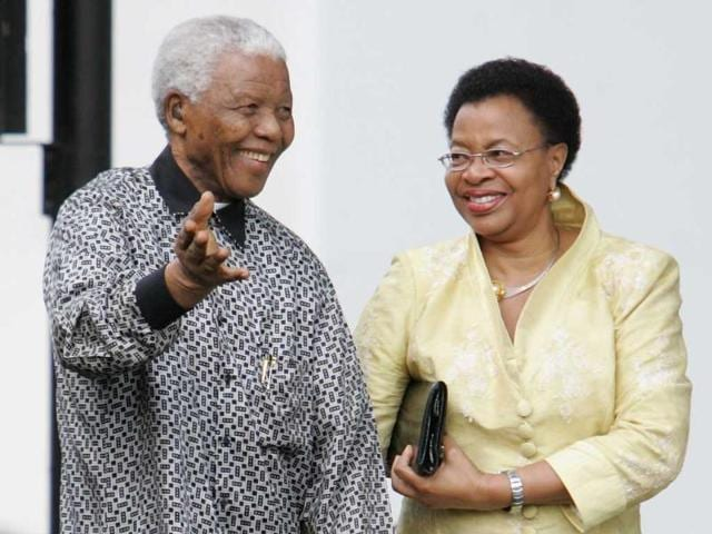 File photo: Former South African president Nelson Mandela and his wife, Graca Machel attend the unveiling of his statue in Parliament square on August 29, 2007 in London, England. Getty Images/Gareth Cattermole