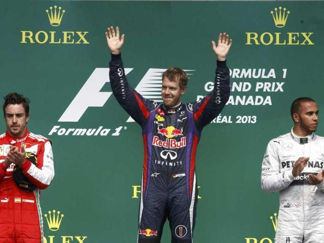 Red-Bull-Formula-One-driver-Sebastian-Vettel-of-Germany-gestures-on-the-podium-after-winning-the-Canadian-F1-Grand-Prix-at-the-Circuit-Gilles-Villeneuve-in-Montreal-Reuters