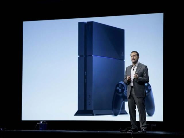 Sony-Computer-Entertainment-president-and-CEO-Andrew-House-addresses-the-media-as-he-stands-in-front-of-a-display-showing-the-images-of-the-new-PlayStation-4-at-the-Sony-PlayStation-E3-media-briefing-in-Los-Angeles-Photo-AP-Jae-C-Hong