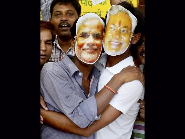 BJP-supporters-in-Patna-wearing-masks-of-Gujarat-CM-Narendra-Modi-and-Bihar-CM-Nitish-Kumar-celebrate-Modi-s-appointment-as-the-chairman-of-the-party-s-election-campaign-committee-PTI-Photo