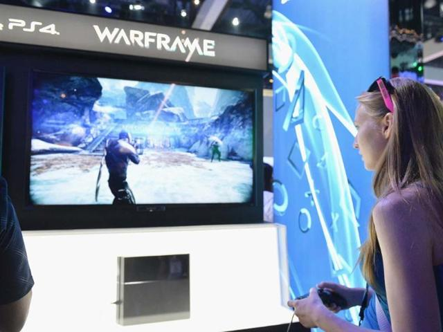 A-fan-enjoys-the-Sony-Play-Station-4-exhibit-on-the-opening-day-at-the-E3-Gaming-and-Technology-Conference-at-the-Los-Angeles-Convention-Center-in-Los-Angeles-California-Alberto-E-Rodriguez-Getty-Images-AFP