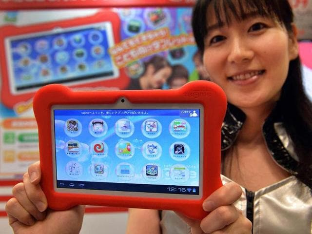 Japanese-toy-maker-MegaHouse-a-subsidiary-of-toy-giant-Bandai-displaying-a-tablet-for-children-called-tap-me-at-the-annual-International-Tokyo-Toy-Show-in-Tokyo-Photo-AFP-Yoshikazu-Tsuno