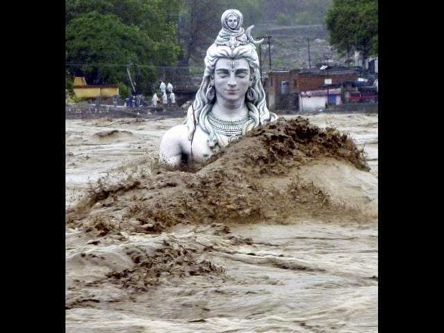 A-submerged-idol-of-Hindu-Lord-Shiva-stands-in-the-flooded-River-Ganges-in-Rishikesh-PTI-photo