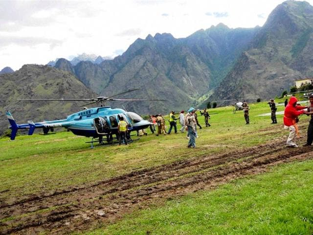 Stranded pilgrims being rescued with the help of helicopters at Joshimath in Chamoli, Uttarakhand. (PTI)