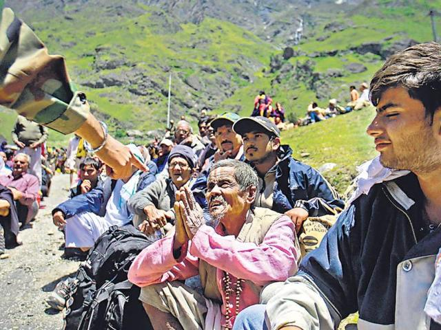 A-survivor-pleads-with-a-soldier-to-allow-him-to-board-a-helicopter-Badrinath-in-Uttarakhand-Reuters