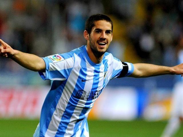 Malaga-s-midfielder-Isco-celebrates-after-scoring-during-the-Spanish-league-football-match-Malaga-CF-vs-Real-Racing-Club-de-Santander-at-Rosaleda-stadium-in-Malaga-AFP-files