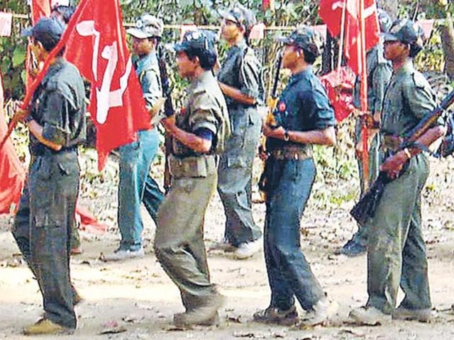 Maoist-rebels-march-during-their-9th-Convention-at-an-undisclosed-location-in-the-jungles-of-Chhattisgarh-AP-Photo