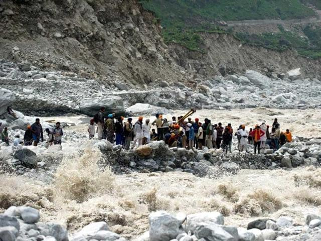 Stranded-pilgrims-wait-to-be-rescued-on-the-side-of-a-river-at-Govind-Ghat--AFP-Photo