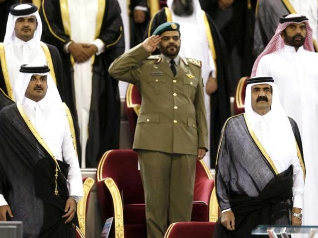 Qatar-s-Emir-Sheikh-Hamad-bin-Khalifa-al-Thani-front-R-stands-next-to-his-son-Sheikh-Tamim-bin-Hamad-al-Thani-front-L-The-Emir-said-on-June-25-that-he-was-stepping-down-and-handing-power-over-to-his-son-Sheikh-Tamim-Reuters