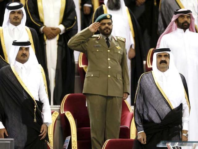 Qatar-s-Emir-Sheikh-Hamad-bin-Khalifa-al-Thani-front-R-stands-next-to-his-son-Sheikh-Tamim-bin-Hamad-al-Thani-front-L-The-Emir-said-on-June-25-that-he-was-stepping-down-and-handing-power-over-to-his-son-Sheikh-Tamim-Reuters