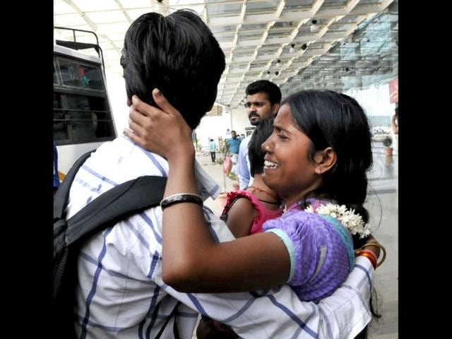 A youth is consoling his sister after she arrived from Uttarakhand by a special aircraft at Raja Bhoj Airport in Bhopal. (Photo by Mujeeb faruqui/HT).