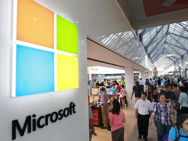 Microsoft-logo-left-is-seen-on-an-exterior-wall-of-a-new-Microsoft-store-inside-the-Prudential-Center-mall-in-Boston-Photo-AP-Steven-Senne
