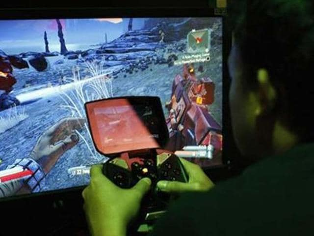 A-man-tries-a-game-at-the-Nvidia-Shield-PC-Game-Streaming-exhibit-at-E3-the-Electronic-Entertainment-Expo-in-Los-Angeles-California-Credit-Reuters-David-McNew