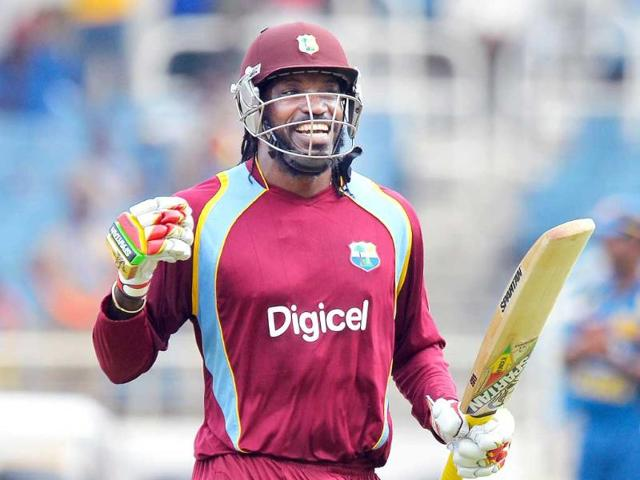 West-Indies-batsman-Chris-Gayle-celebrates-after-scoring-a-century-against-Sri-Lanka-during-the-first-match-of-the-Tri-Nation-series-at-the-Sabina-Park-stadium-in-Kingston-AFP