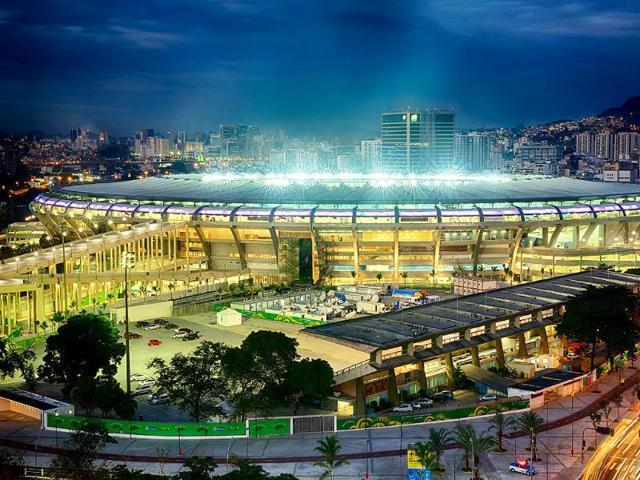 Maracana football stadium,shirtless fans,musical instruments